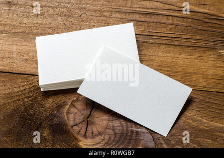 white blank business card on a wooden background - Stock Image