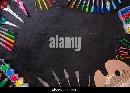 School supplies on a chalkboard background - Stock Image