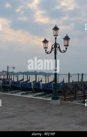 Gondola with a streetlamp Venice - Stock Image