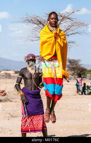 Samburu Maasai man or warrior doing the traditional jumping dance, Samburu, Kenya, East Africa - Stock Image