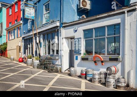 23 May 2018: Kingswear, Devon, UK - The Steam Packet Inn in Fore Street, where it overlooks the River Dart. - Stock Image