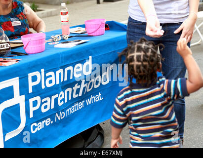 Planned Parenthood booth. - Stock Image