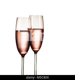 Pink champagne in two glasses, in detail, isolated on white background - Stock Image