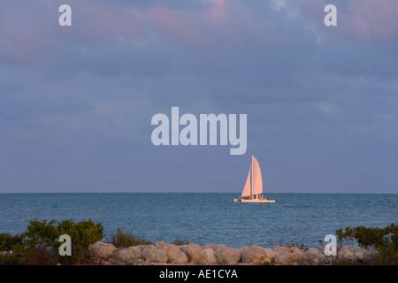 Sailboat off Duck Key at sunset Hawks Cay Resort Florida USA - Stock Image