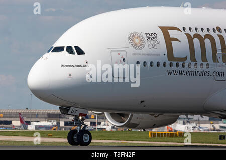 An Emirates Airbus A380, registration A6-EUT, preparing for take off from Manchester Airport, England. - Stock Image