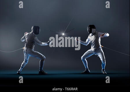 Men electric epee fencing - Stock Image