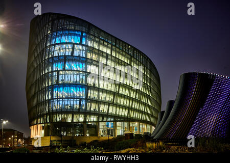 At night the NOMA development One Angel Square landmark head office of the Co-operative Group,  stainable energy credentials architecture - Stock Image