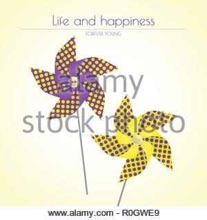 Colorful violet and yellow pinwheels - Stock Image