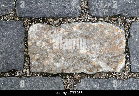 Beautiful floor made with grey and light beige tile-shaped rocks. This is outdoors flooring in a closeup photo. - Stock Image