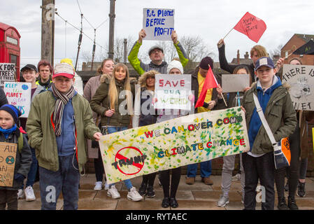 Preston, Lancashire. 15th March, 2019. School strike 4 Climate change as parents and school children assemble outside the railway station with banners and placards protesting for action against climate change.  The demonstrators marched through the city centre to continue their protest at the Flag Market in the city centre. Children from around Lancashire have walked out of classes today as part of an international Climate Strike. Credit:MWI/AlamyLiveNews - Stock Image