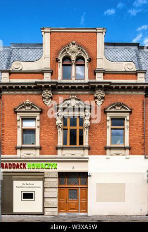 Walter Baddack Funeral Parlour in Historic red brick apartment & shop building on corner of Oberhofer Weg & Kranoldplatz in Lichterfelde-Berlin. Exter - Stock Image