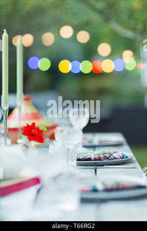 Placesettings on dinner garden party table - Stock Image