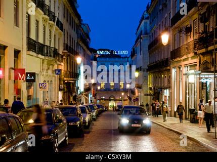 Rua Garrett in Lisbon's Chiado district at dusk - Stock Image