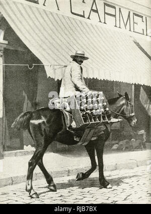 Man on horseback, delivering a crate of beer in the city of Valparaiso, Chile, South America, which is too hilly for wheeled vehicles. - Stock Image