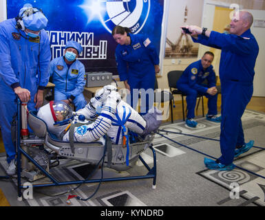 Expedition 53 flight engineer Joe Acaba of NASA has his Sokol suit pressure checked as Expedition 53 backup crew - Stock Image