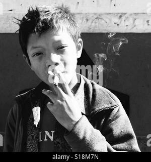 Boy smoking - Stock Image
