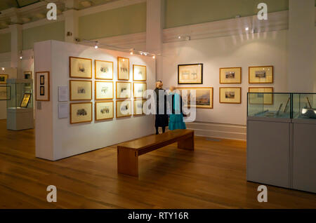 Mercer Art Gallery in Harrogate interior with two lady visitors viewing art work about the town - Stock Image