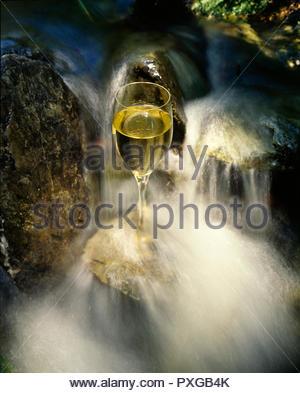 wine glass in waterfall - Stock Image