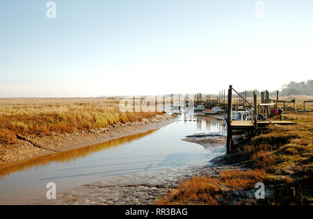 A view of the harbour and quayside in North Norfolk at Thornham, Norfolk, England, United Kingdom, Europe. - Stock Image