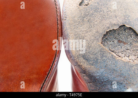 A conceptual picture of an old sole of a shoe and a brand new one - new versus old - Stock Image