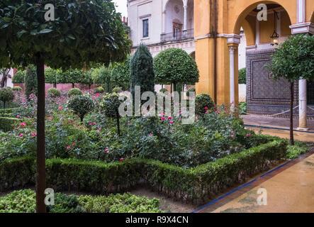 Garden inside Casa de Pilatos (Pilate's House), a Mudejar style palace used by the Dukes of Medinaceli, Seville, Spain - Stock Image