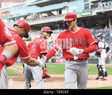 Los Angeles Angels' designated hitter Shohei Ohtani celebrates with teammates after hitting a two-run home run in the third inning during the Major League Baseball game against the Minnesota Twins at Oriole Park at Target Field in Minneapolis, Minnesota, United States, May 13, 2019. Credit: AFLO/Alamy Live News - Stock Image