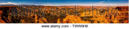 Panoramic view of Badlands from Mirador del Fin del Mundo (the towns of Purullena-far left, Los Banos-above, center and Purullena-far right), near Gua - Stock Image
