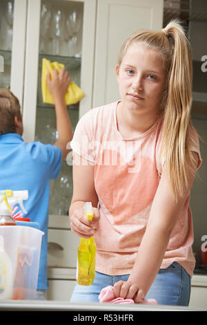 Unhappy Children Helping to Clean House - Stock Image