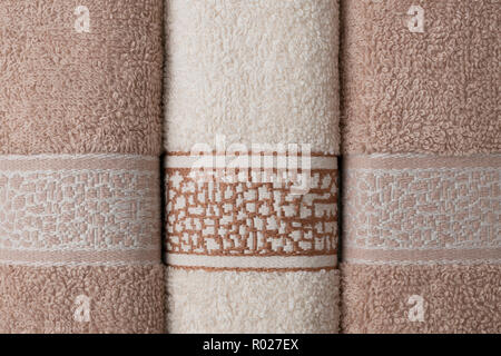 Bath towels lined up on the table, macro shot background - Stock Image