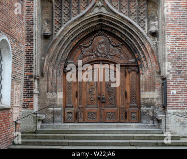 Munich, Bavaria, Germany - May 29, 2019. Door outside of Frauenkirche viewed from below illustrating gothic style and stunning symmetry - Stock Image