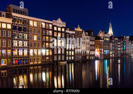 Traditional Dutch buildings at Damrak in Amsterdam, Netherlands - Stock Image