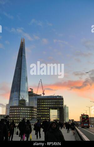 Shard Skyscfraper building, surounding offices and people walking on London Bridge, London, England, UK - Stock Image