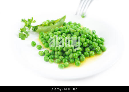 Organic green peas with melted butter and sea salt. - Stock Image