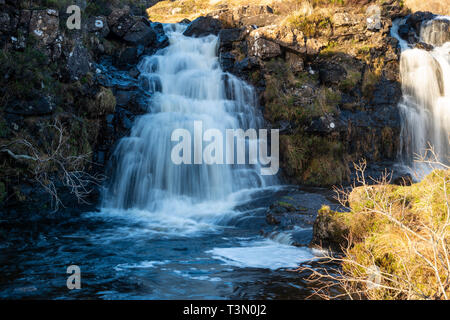 Twin waterfalls next to footpath leading to Fairy Pools on Isle of Skye, Highland Region, Scotland, UK - Stock Image