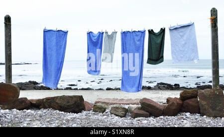 Blue towels on a washing line in Scotland, UK - Stock Image