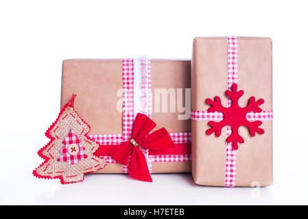 Christmas decoration and gifts on white background - Stock Image
