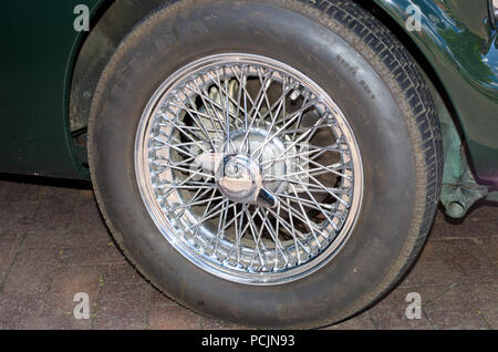 Classic car wire wheel UK - Stock Image
