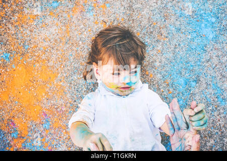 Little girl dirty of paint - Stock Image