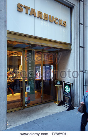 In 2015, Starbucks opened its first-ever express format store at 14 Wall Street in New York City. - Stock Image