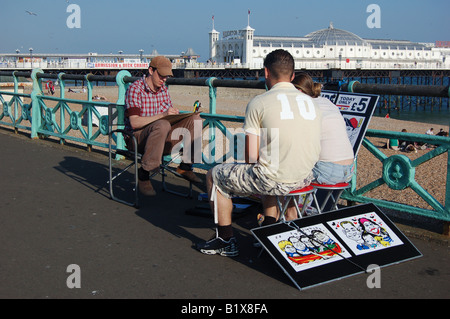 Artist at work, Brighton seafront, England - Stock Image
