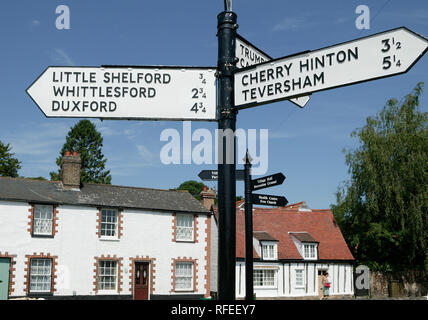 20th century black and white road traffic sign at Great Shelford routes to Cherry Hinton Duxford Little Shelford Teversham Whittlesford Cambridgeshire - Stock Image