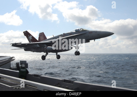 An F/A-18C lanches from USS Dwight D. Eisenhower. - Stock Image