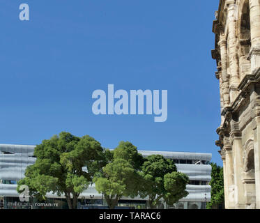 Exterior of the Arena and the Musee Romanite in Nimes, France, Europe - Stock Image