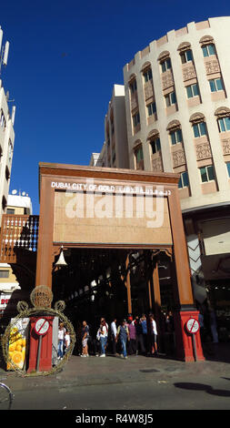 Tourists at the main gate of Gold Souk or the City of Gold in Dubai. - Stock Image