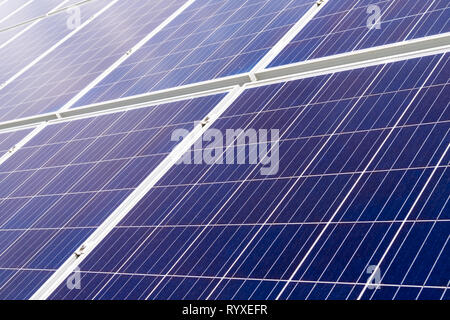 Closeup on solar cell photovoltaic panels at energy production plant. Solar renewable energy concept - Stock Image