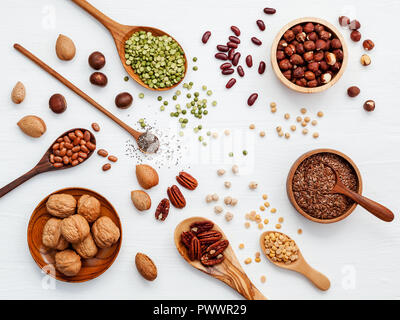 Various legumes and different kinds of nuts walnuts kernels ,hazelnuts, almond kernels,brown pinto ,soy beans ,flax seeds ,chia ,red kidney beans and  - Stock Image