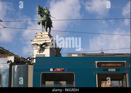 a tram and Garibaldi Statue in Cairoli Square, Milan, Italy - Stock Image
