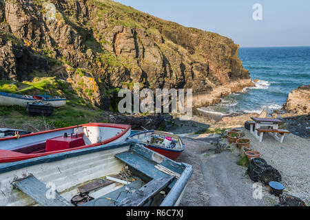Boats drawn up on the slipway at Church Cove on the Lizard Peninsula, near Lizard village in Cornwall, England - Stock Image