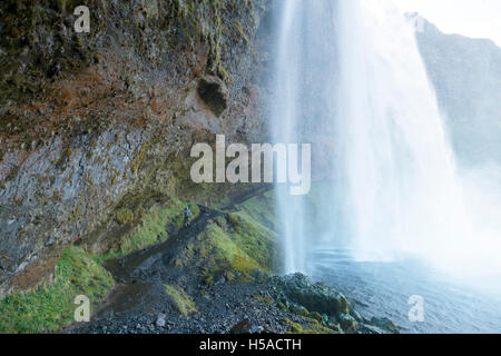 Behind the Seljalandsfoss waterfall -Southern Iceland showing path behind the falls - Stock Image
