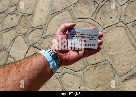 A man's hand holding a boarding pass for a River Nile cruise ship called the M/S Royal Esadora, Egypt, Africa - Stock Image